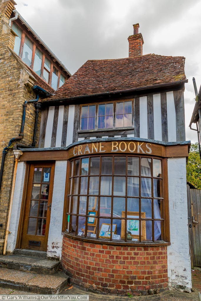An intriguingly named shop called Crane Books, a play on words for the town's name of Cranbrook.  The rather uneven shop shows the signs of age looking like a mix of styles from late Tudor to more modern times.