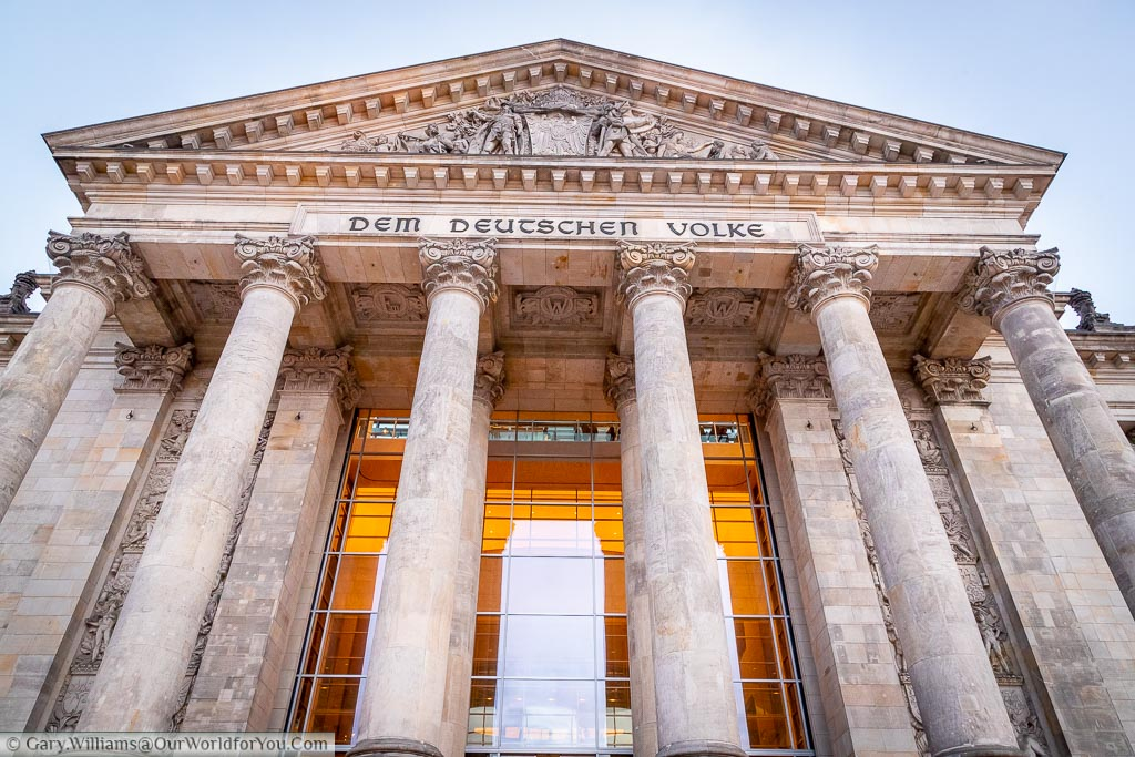 The neoclassical entrance to the Reichstag.  Inscribed above it, in German, is the phrase 'The German people'