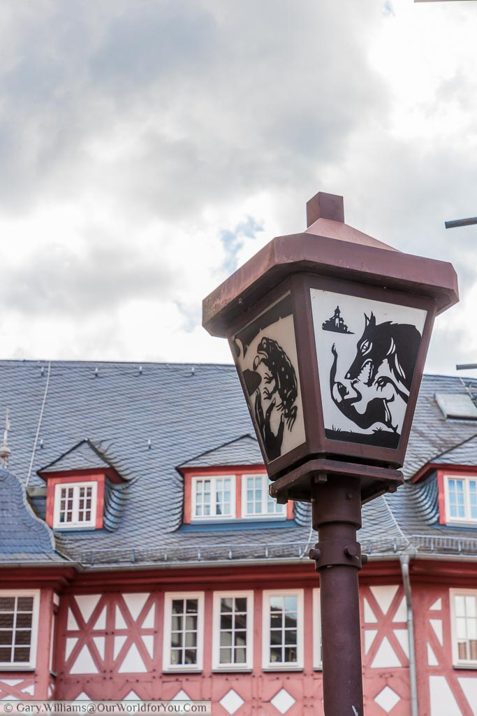 Another close-up, this time of a free-standing street lamp depicting yet another image from local traditions.