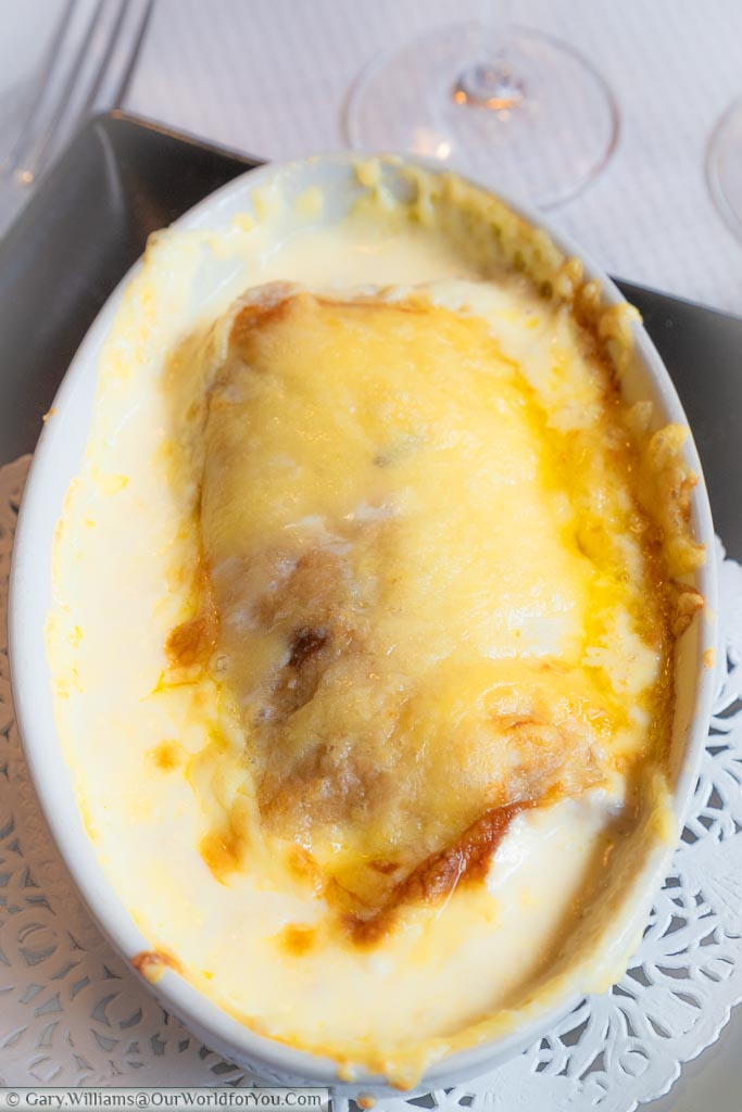 The Ficelle Picarde, a regional dish of Picardy, consisting of a pancake stuffed with cheese, mushrooms and ham, covered in a creamy cheesy sauce served in an oval pie dish