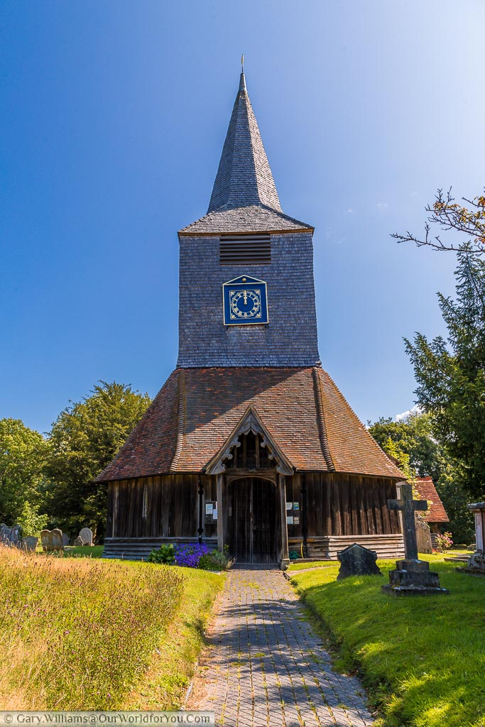 A pathway leading to the historic Church of Saint Mary's with its timbered tower in the village of High Halden, Kent