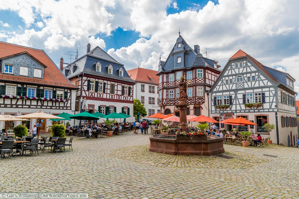 The view of market platz with its stone fountain taking centre stage against the backdrop of half-timbered buildings