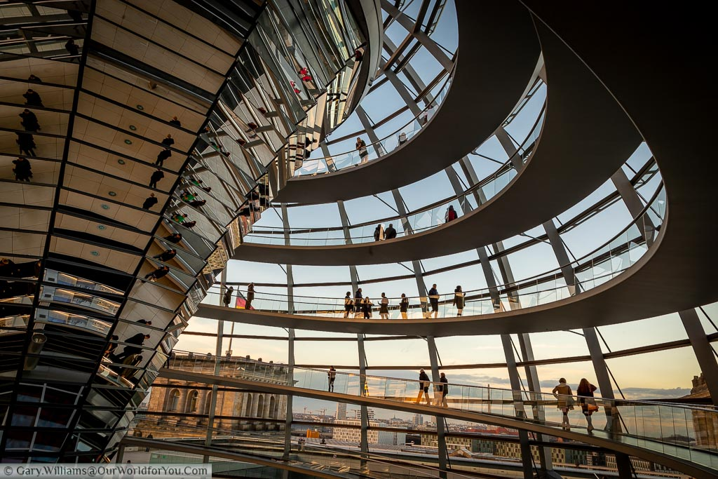Inside the dome of the Reichstag. A spiral staircase take you to the top, and other back down.  The central inverted reflector transfers daylight down to the debating chamber below.