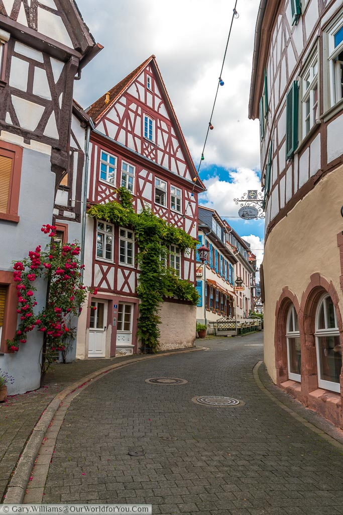 A cobbled lane leading past half-timbered houses towards the centre of the Old Town of Heppenheim.