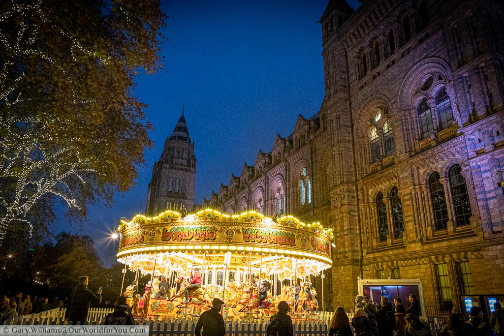 A traditional carousel in front of the Natural History Museum In London's South Kensington.