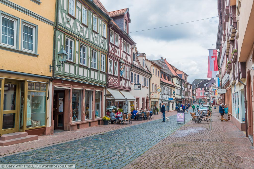 A view along Miltenberg's main Street lined with half-timbered buildings that now are home to quirky shops and cafes