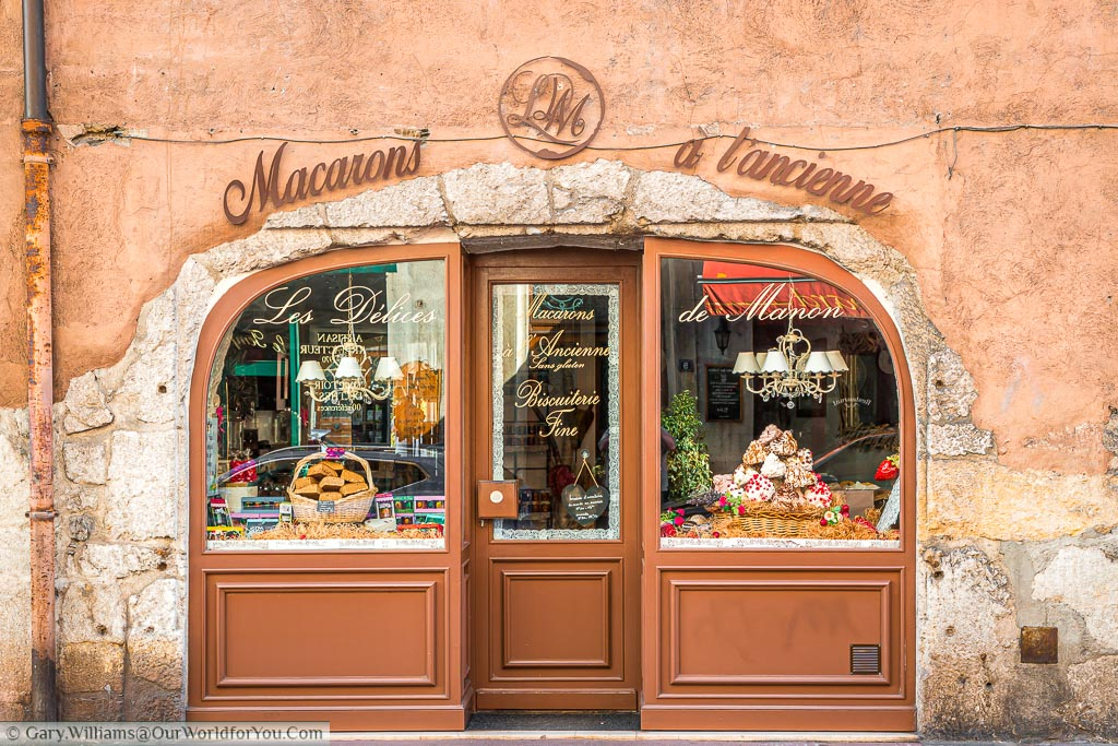 A traditional macaron shop in a side street in Annecy.  Shop windows are full of tempting local sweet delicacies.