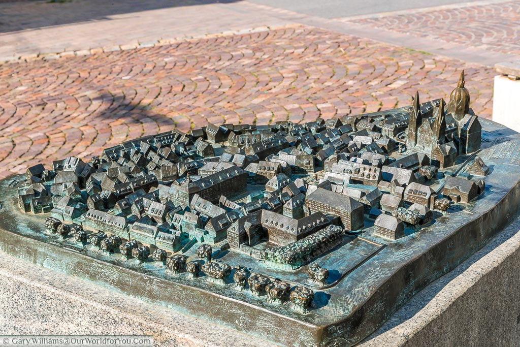 A tactile brass 3D map of the Old Town of Heppenheim with the cathedral dominating the town