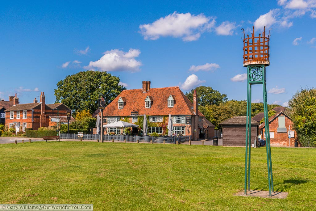 An iron beacon on the village green of High Halden in front of the Chequers Inn.
