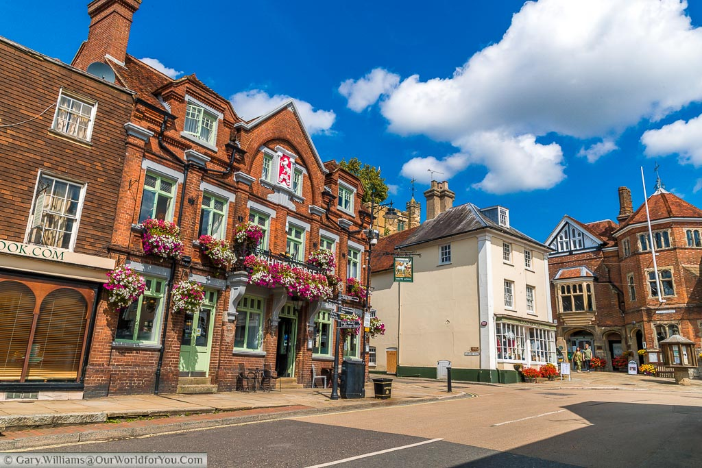 The White Horse public house takes pride of place in the High Street of Cranbrook.  The windows are decorated with brightly coloured hanging baskets.
