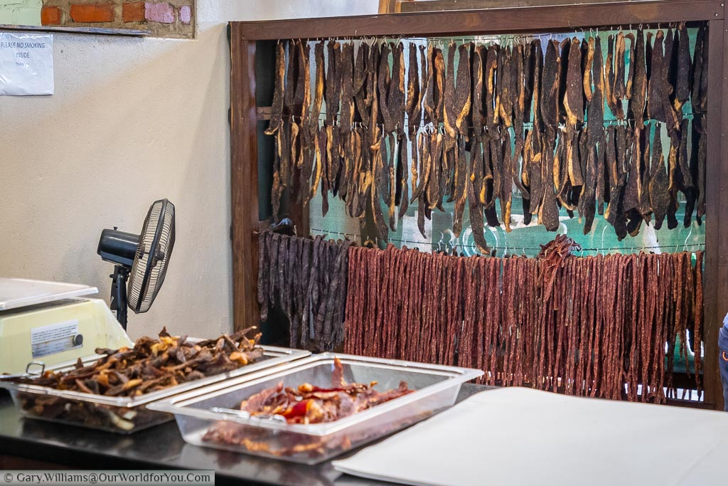 Rows of biltong hanging in the air at Saucy Sues, a stopover at Lions Den, on the road to Lake Kariba.