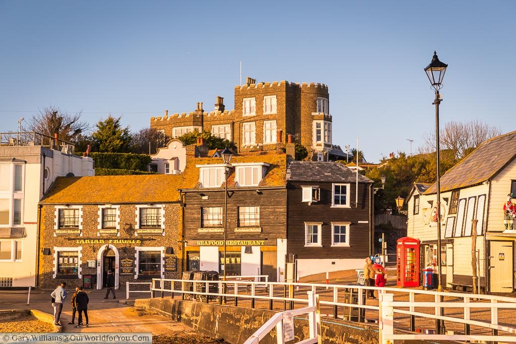 The view from the Harbour towards the Tartar Frigate pub with Bleak House on the hillside above.