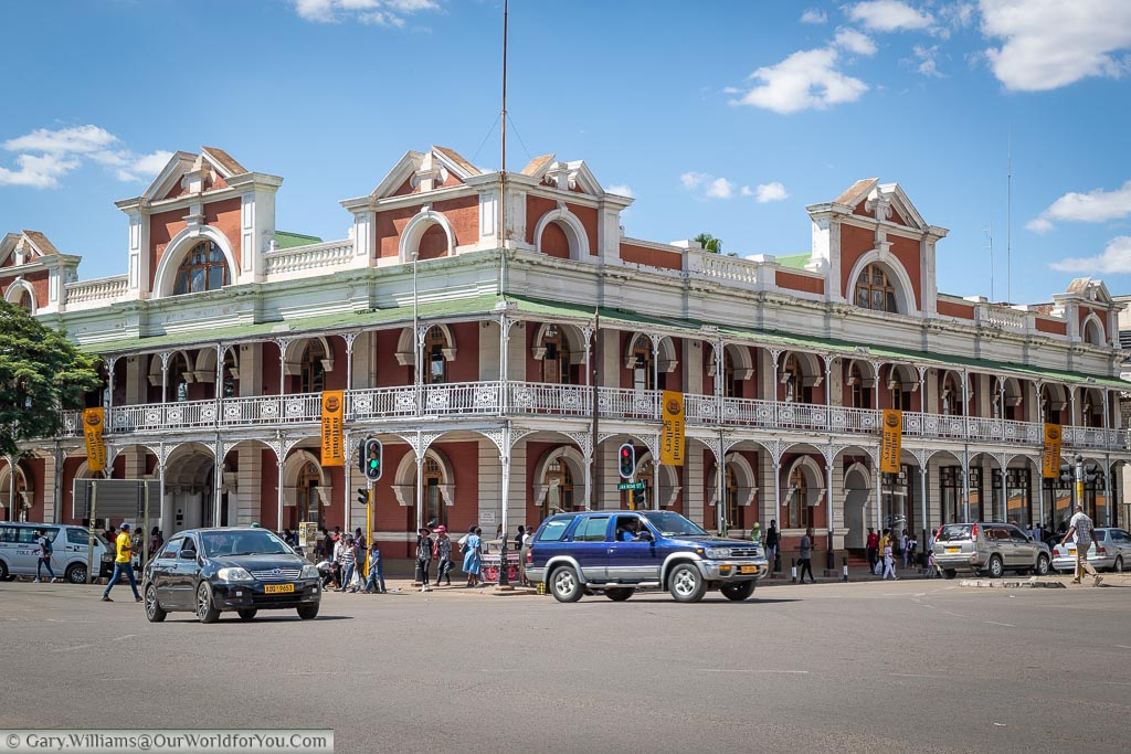 Looking across a busy junction at a colonial-era building that now houses the Bulawayo Art Gallery.