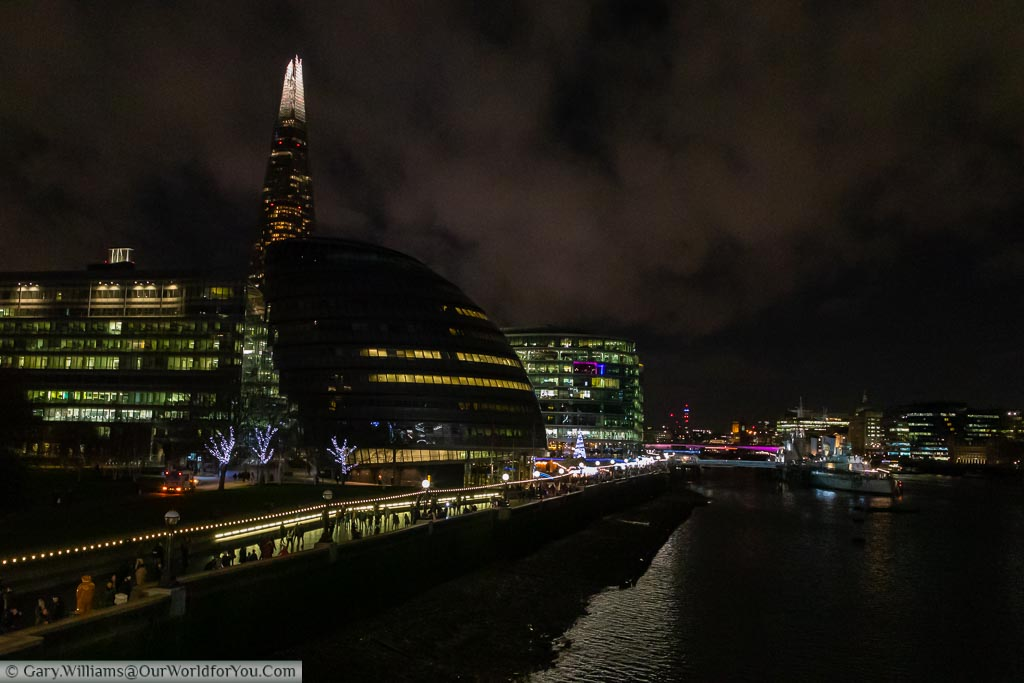 A view of the River Thames towards London Bridge with City Hall and the 'Christmas by the River' Market on the south bank.