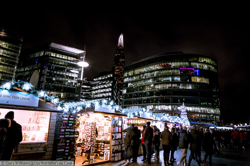 Stalls of Christmas by the River Market with the Shard in the background