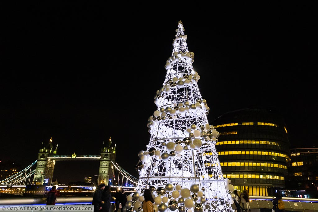 The Christmas Tree in front of London's City Hall with the Tower of London in the background.
