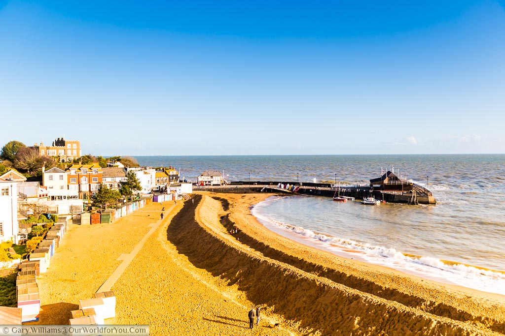 Looking over the Golden sands of Viking Bay in Broadstairs towards the Harbour arm where the sand on the beach group prepared for winter by creating a sandy break water