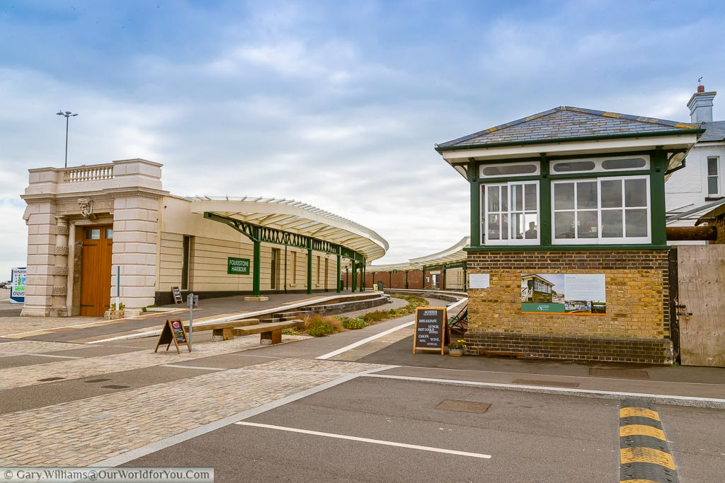 The old Folkestone Harbour station, signal box and Customs House.  Freshly pained and repurposed as an entrance to the Harbour Arm with bars and restaurants.  The centre of the tracks has now been replanted with a garden, but many of the original features remain.