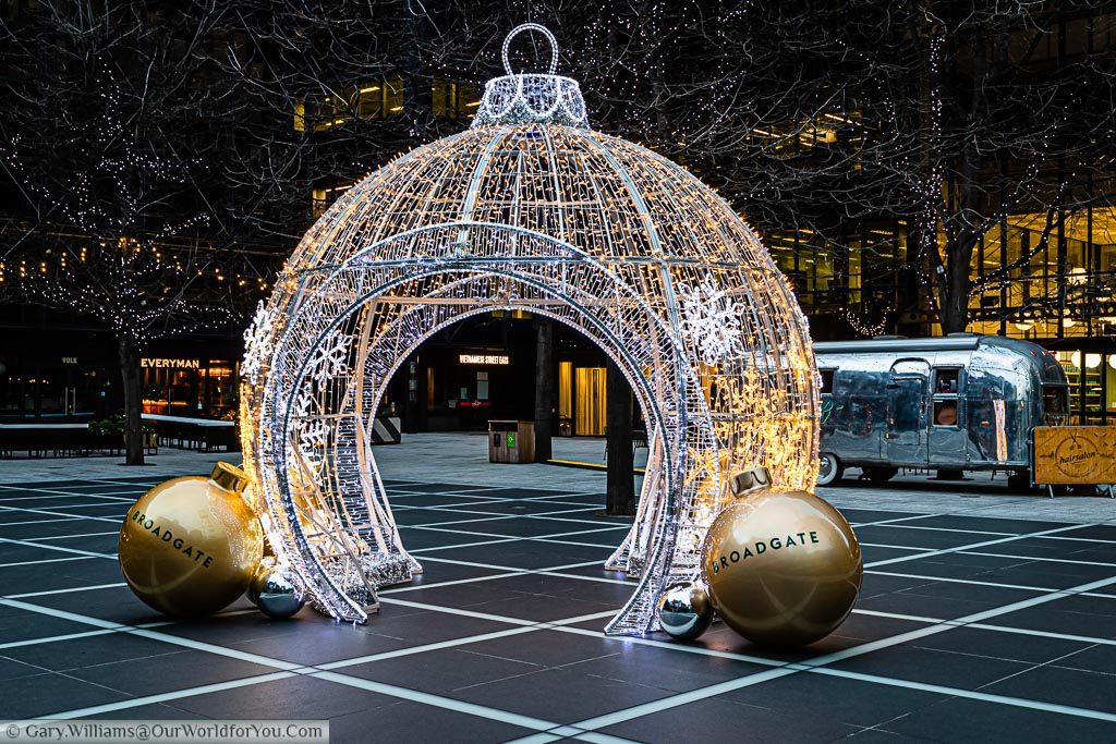 Giant walkthrough Christmas bauble constructed purely out of fairy lights in the Broadgate Centre in London