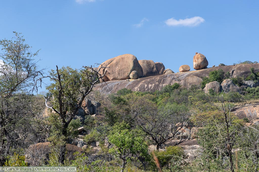 Worn granite boulders balanced high on the rock formation.