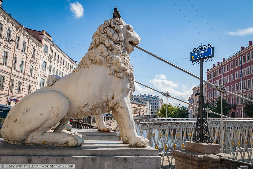 One of the stone lion statues at the end of the Lion Bridge in Saint Petersburg, Russia