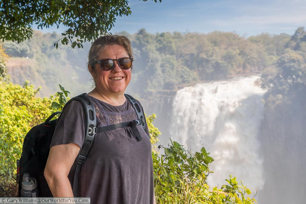 Janis standing at a viewpoint overlooking the Devil's cataract part of Victoria Falls.