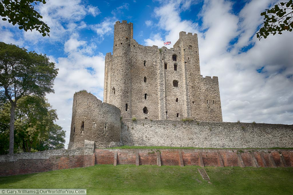 Looking up at the Keep of Rochester Castle from the now dried out moat that surrounds it.