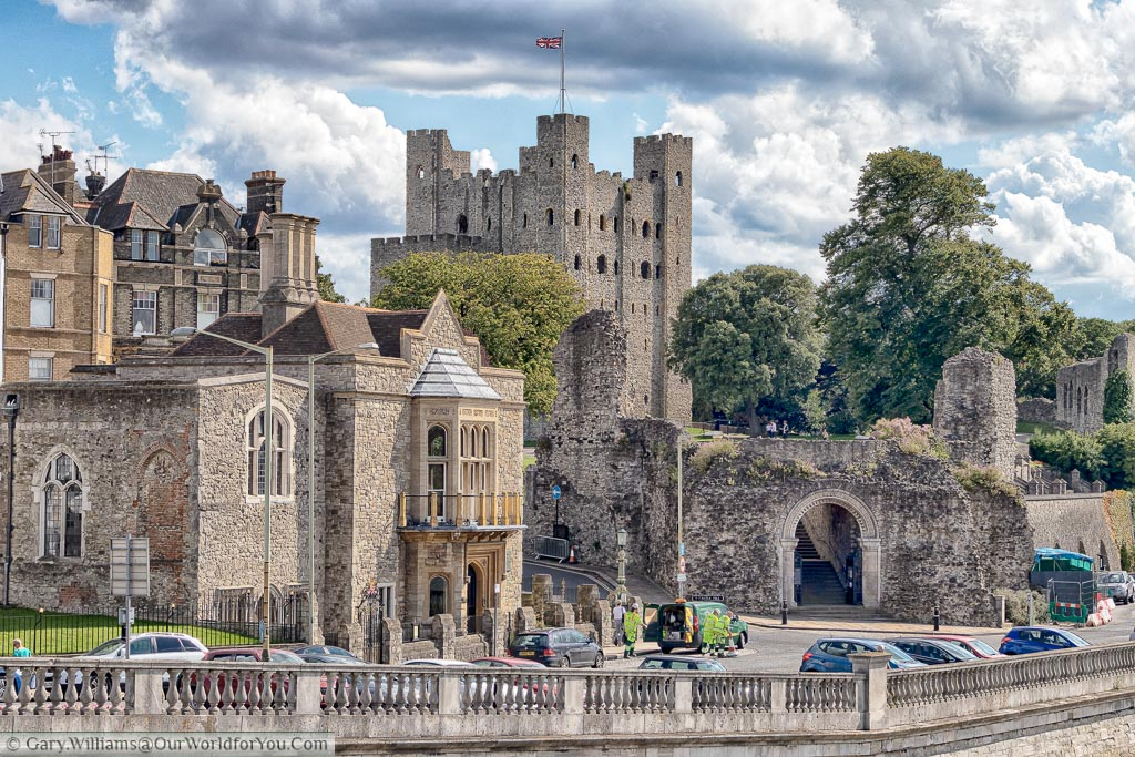 View from Rochester bridge overlooking the promenade and the entrance to Rochester Castle with the Keep high on the hill above.