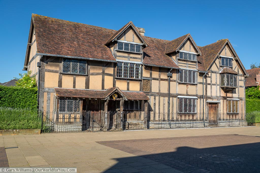 Shakespeare's house in the centre of Stratford upon Avon. The beige coloured half-timbered Tudor home stands now was a museum to the playwright's legacy.