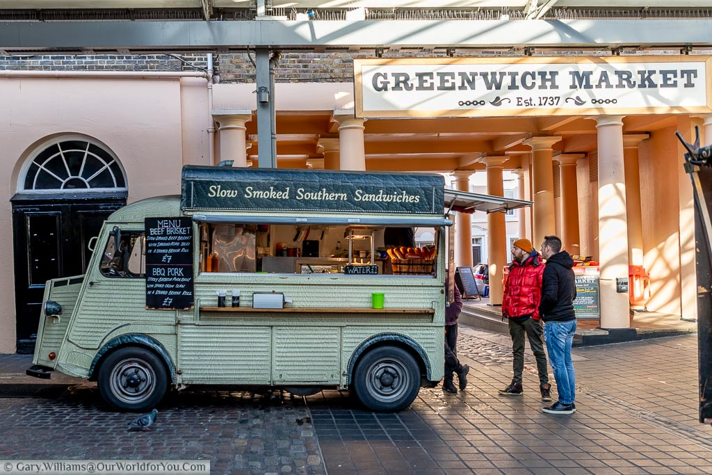 The food stall offering slow cooked barbecue sandwiches in Greenwich market being operated out of an old Citroen van