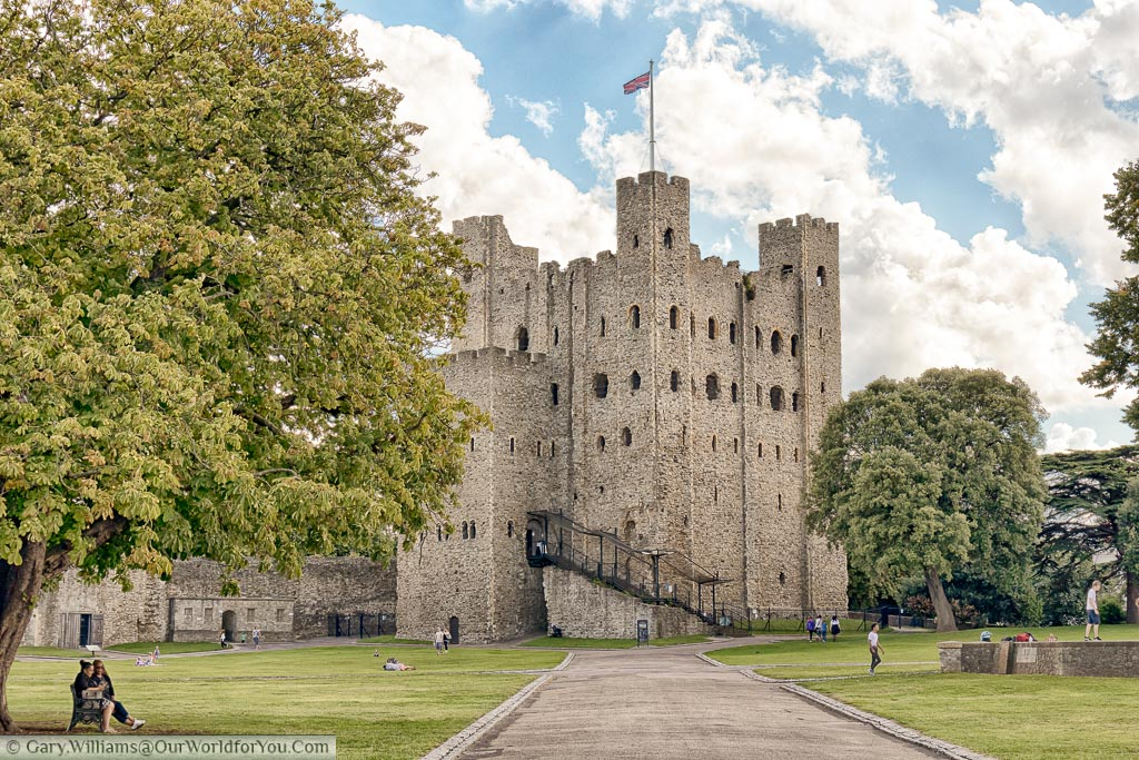 The view from inside Rochester Castle grounds looking towards the Norman Keep, With the union flag fluttering in the breeze.