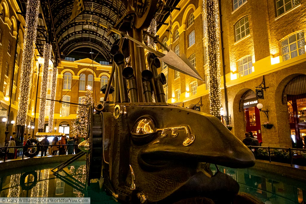 A close-up of the art installation 'The Navigators', a surrealist ship with a large face, in Hay's Galleria at Christmas.