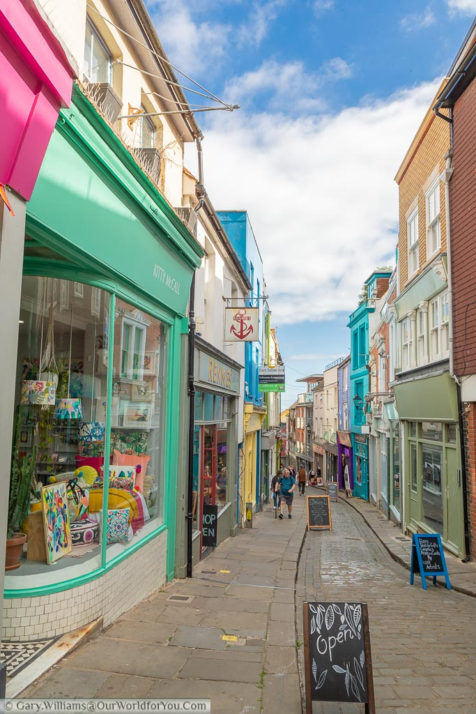 The Old High Street in Folkestone lined with brightly coloured, quirky shops and boutiques.