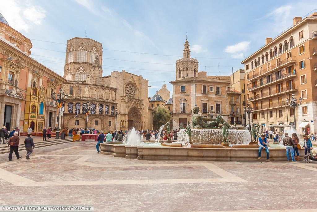 The Plaza de la Virgen in Valencia with the Neptune fountain taking centre stage with the city's historic cathedral in the background.