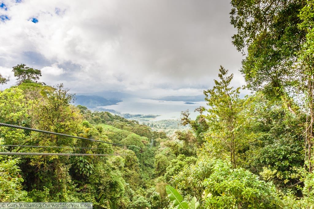 A view from the Sky tram platform in the Arenal Volcano National Park through the rain forest to Lake Arenal.