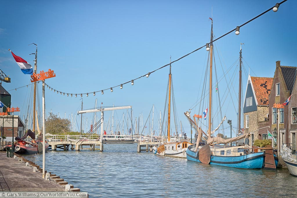 Dutch sailing barges mood at the quayside of Monnickendam in Holland on a beautiful spring day perfectly clear blue skies.