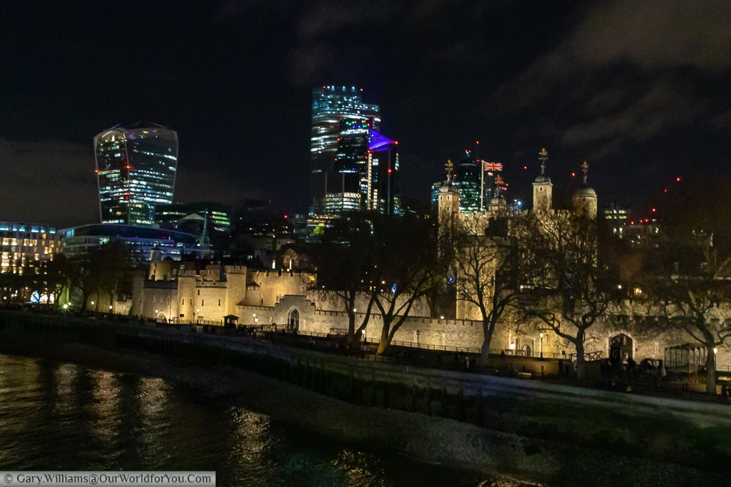 The Tower of London from Tower Bridge and the modern city skyline in the background.