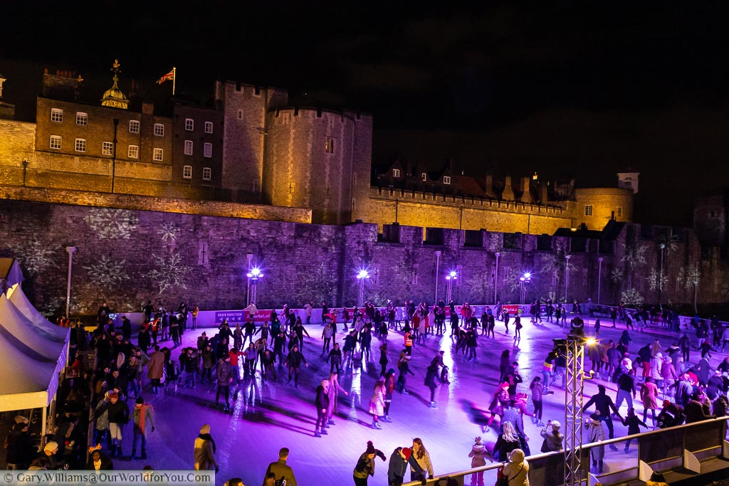 The Tower of London ice rink in front of the boundary walls with the historic buildings in the background.
