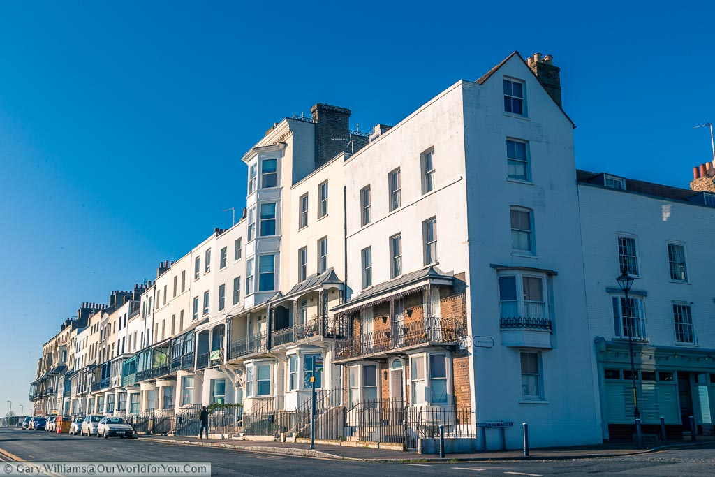 An elegant parade of period houses that face the sea front. Each one has its own covered balcony giving excellent views of the coastline