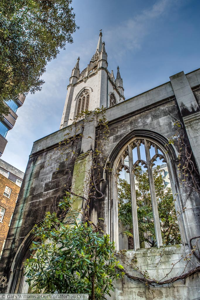Looking up at the tower of Saint Dunstan's in the East church ruins that is now home to gardens have enjoyed by visitors and city workers alike