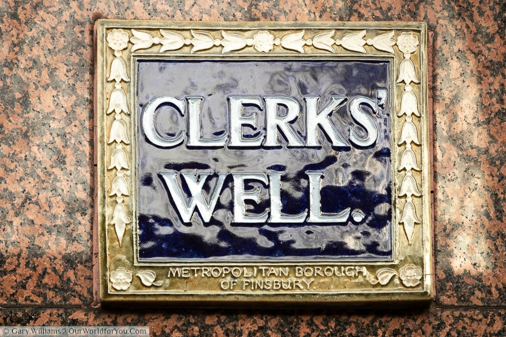 A tiled blue plaque from the Metropolitan Borough of Finsbury indicating the site of Clerks' Well