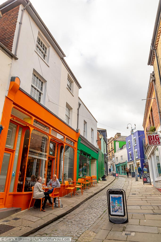 Looking up Folkestone's old High Street with a narrow cobbled lane in the centre and brightly coloured artisan shops either side that now occupies the creative quarter of the town.