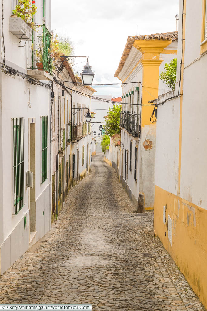 A quiet, traditional, cobbled, lane in Évora