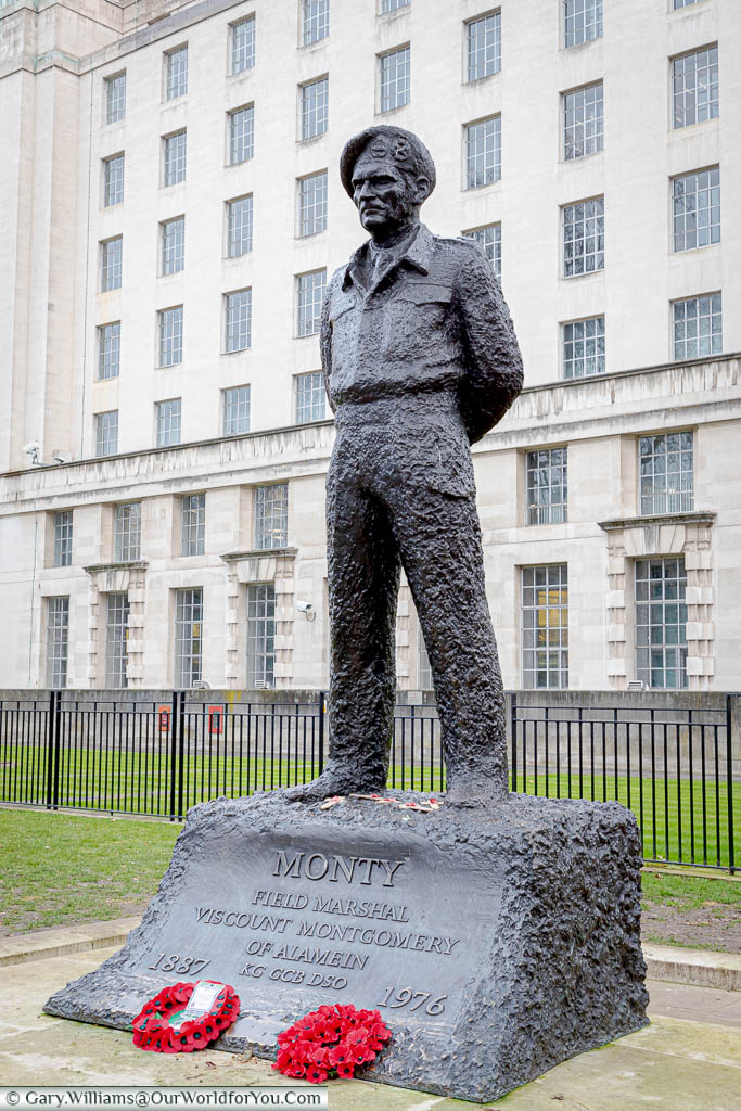 A brass statue to 'Monty', or Bernard Montgomery, 1st Viscount Montgomery of Alamein, in full desert battle dress in front of the Ministry of Defence building