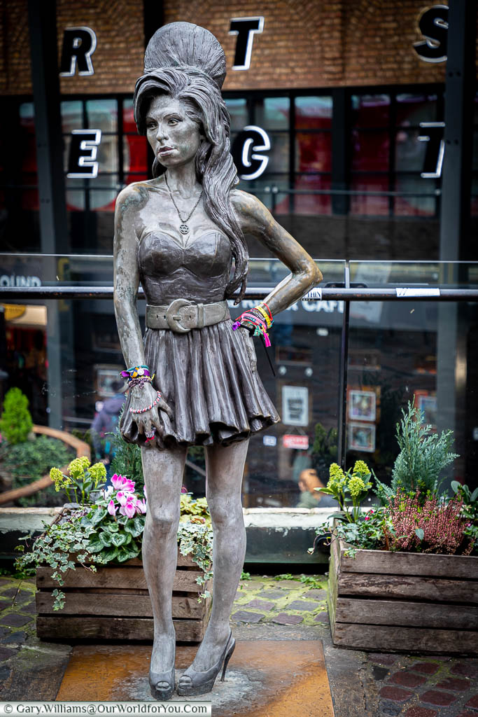 A statue to the late music artist Amy Winehouse, complete with beehive hairstyle, in Camden Market.