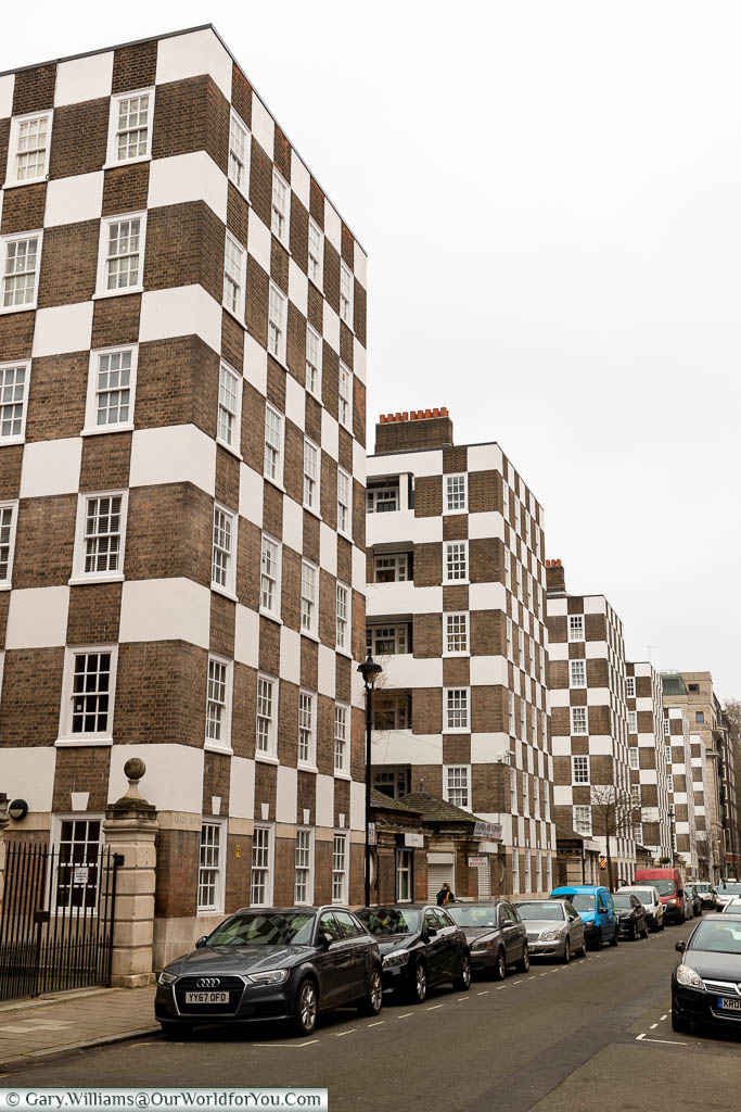 A series of six-storey social housing tower blocks in Westminster featuring an unusual checkerboard facade.