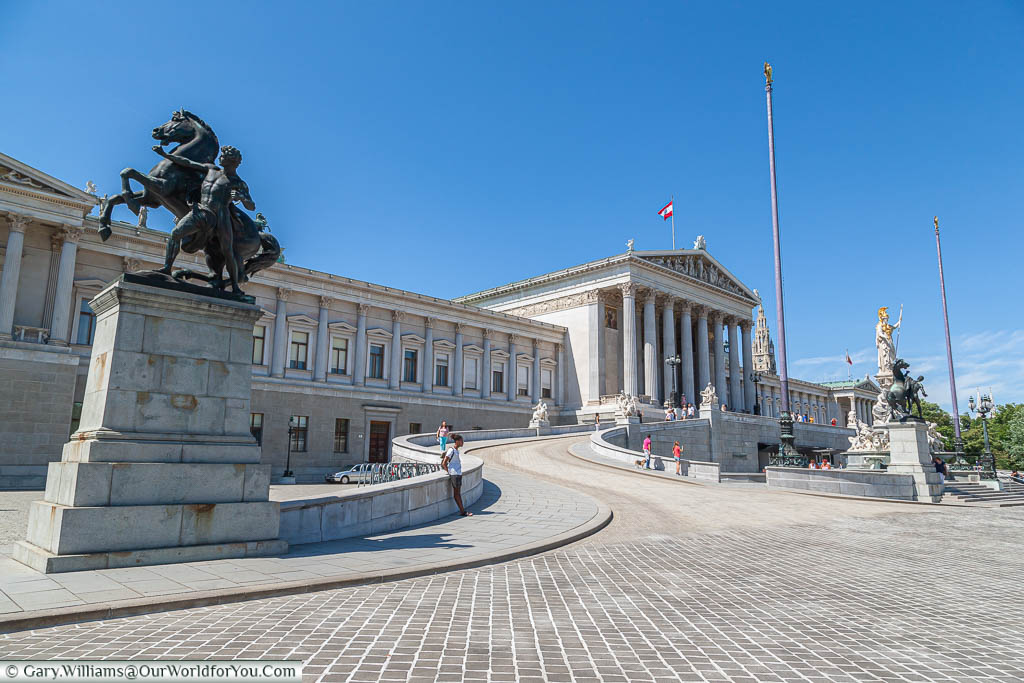 A sweeping path up to Austria's parliament building in Vienna.  The huge building was built in the late 19th century in a Greek revival style.