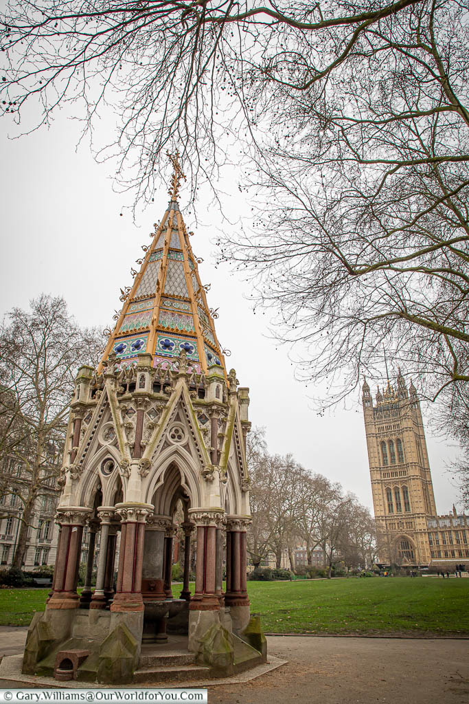The Buxton Memorial Fountain, a communal water fountain covered by a decorative neogothic spire, set in Victoria Tower Gardens, next to the Palace of Westminster.