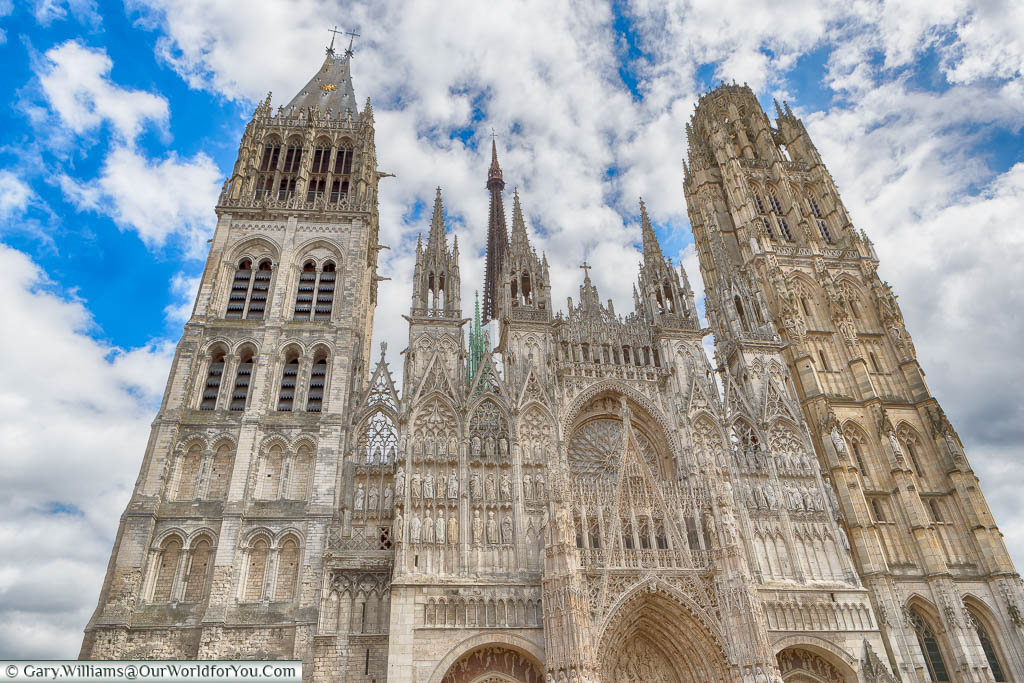 Looking up at the twin stone towers either side of the entrance to Rouen Cathedral, one of the most impressive in all Normandy,