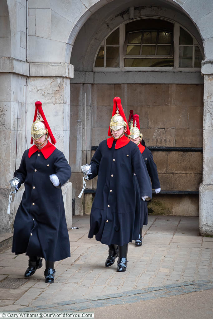 Three sentries from the Blues and Royals, march toward us, leaving one in position, during the changing of the guard.